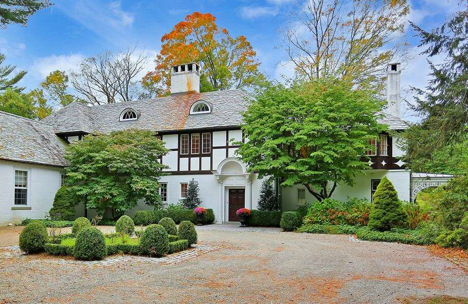 The main house at Connecticut's Quiet Lake Estate straddling the Wilton-New Canaan line. (Tranzon Auction Properties photo via PRNewswire)