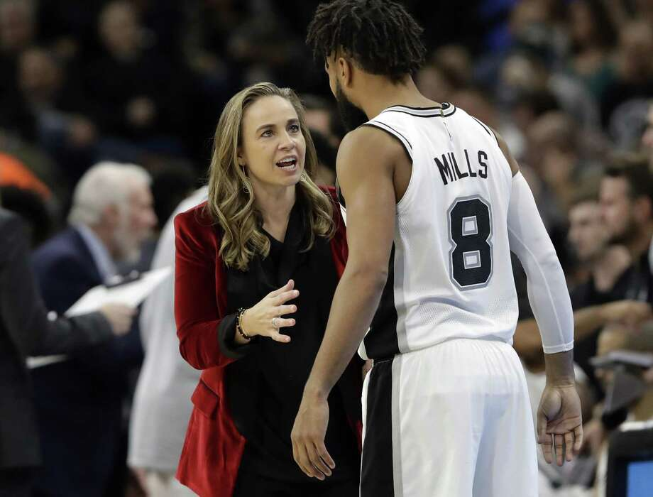 San Antonio Spurs assistant coach Becky Hammon, left, talks with guard Patty Mills (8) during the second half of an NBA basketball game against the New York Nets, in San Antonio. Click through to see 10 reasons why Hammon rocks. Photo: Eric Gay /Associated Press / Copyright 2018 The Associated Press. All rights reserved.