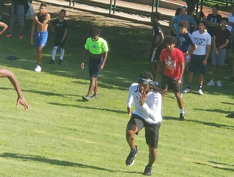 PHOTOS: A look at DeAndre Hopkins' workout at Herrman Park. Sprinting up a steep hill at Hermann Park on Wednesday morning, Texans All-Pro wide receiver DeAndre Hopkins offered encouragement to a group of youth athletes he assembled for an impromptu workout. Browse through the photos above for a look at DeAndre Hopkins' workout at Hermann Park. Photo: Aaron Wilson/Houston Chronicle