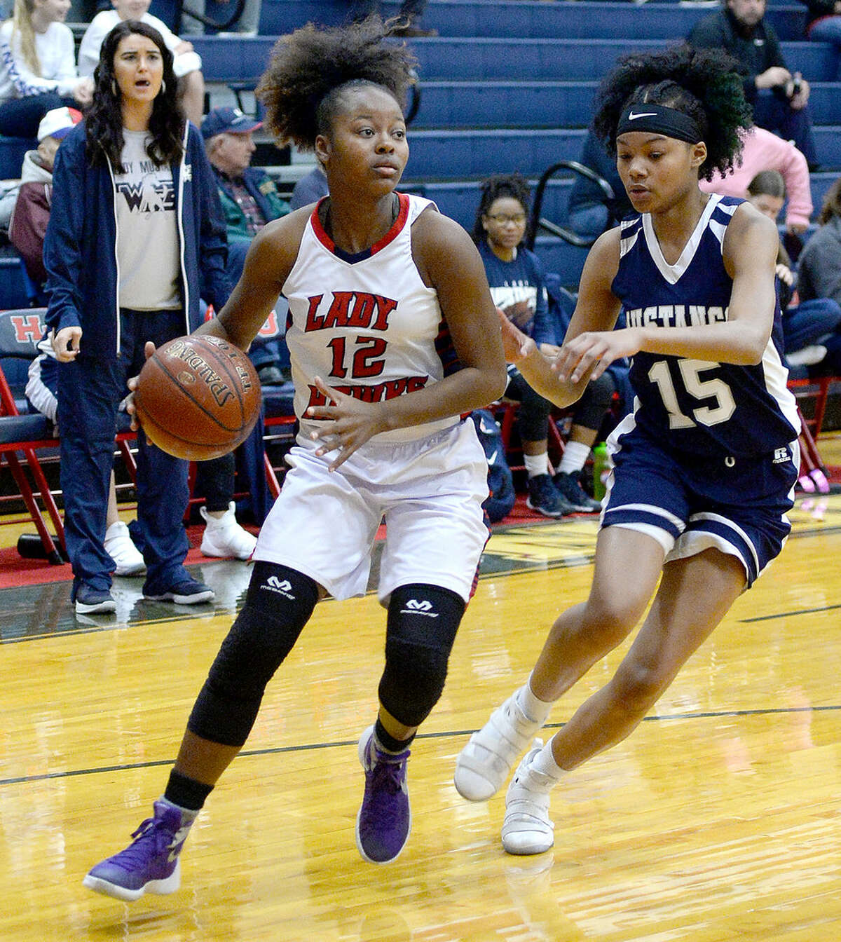 Hardin-Jefferson's Alexis Wheeler is paced by West Orange-Stark's Mar'Landria Hebert during their match-up in Sour Lake Tuesday. Photo taken Tuesday, January 2, 2018 Kim Brent/The Enterprise