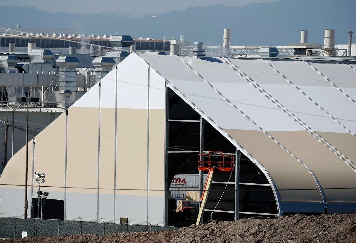 A large temporary building is erected in a back lot of the Tesla manufacturing plant in Fremont, Calif. on Wednesday, June 27, 2018. Tesla is assembling the new Model 3 sedan in the tent-like structure to meet demand and deadlines.