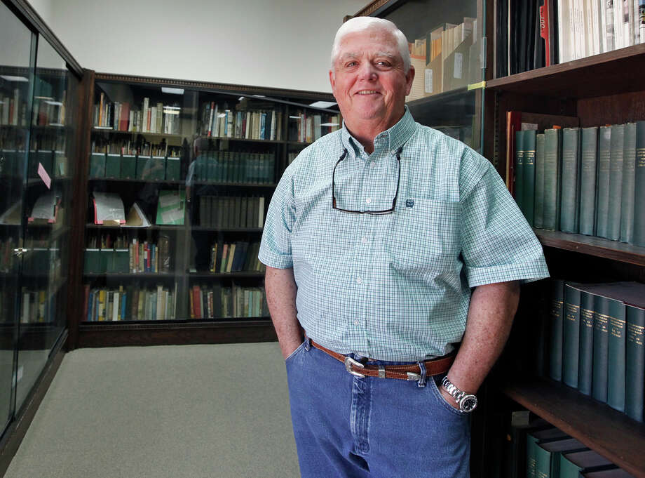 In this May, 30, 2018 photo, Midland native Pat McDaniels who has worked in Haley Memorial Library and History Center since 1995, poses for a photo in Odessa, Texas. As a charitable trust, the library receives no money from tax agencies and operates on private donations alone. (Jacob Ford/Odessa American via AP) Photo: Jacob Ford, AP / (C) The Odessa American