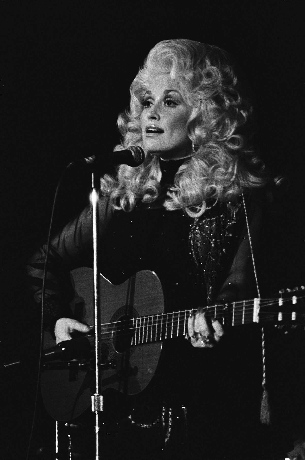 Dolly Parton performs live at The Boarding House Nightclub in 1976 in San Francisco.