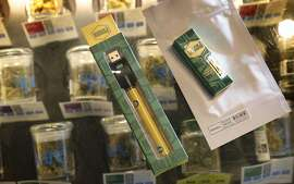A Marigold marijuana vape pen and Cannibis oil sold at Sparc dispensary in San Francisco, Calif., on Tuesday, June 26, 2018. New regulations for recreational Marijuana packaging take effect on July 1, and sellers are moving non-conforming products in anticipation of the changes.