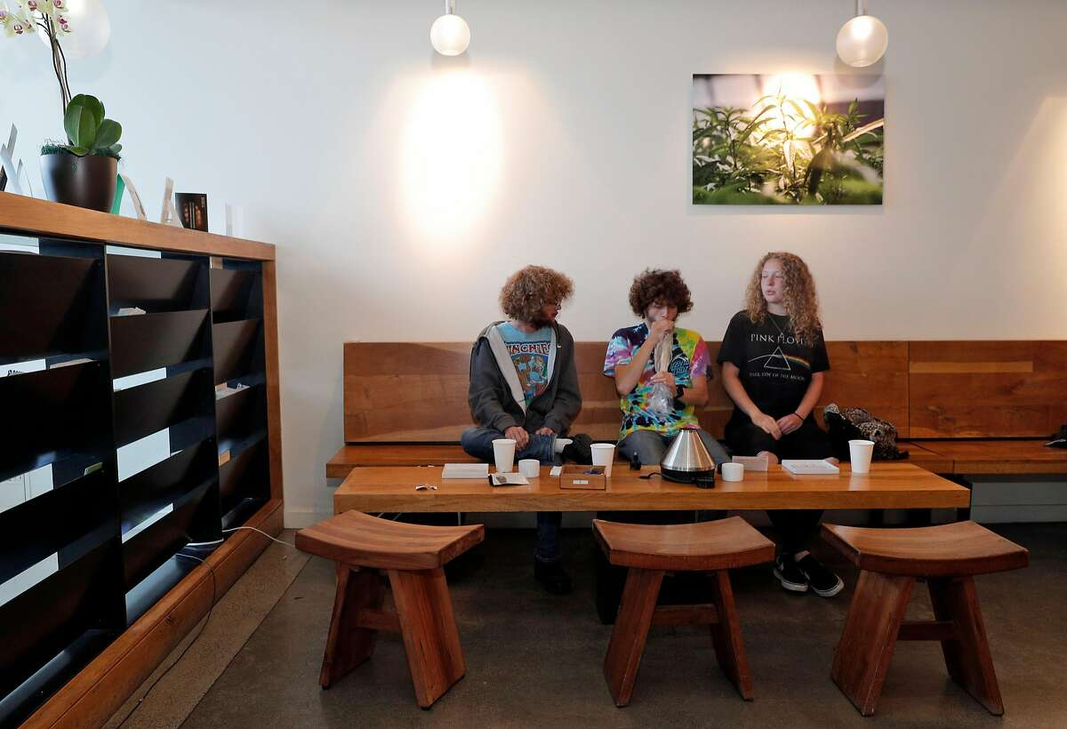 Zach Pascarosa, from Pennsylvania, Marcus (no last name given) from Manhattan, center, and Hannah Tollinger, from Pennsylvania, sample some products at Sparc dispensary in San Francisco, Calif., on Tuesday, June 26, 2018. New regulations for recreational Marijuana packaging take effect on July 1, and sellers are moving non-conforming products in anticipation of the changes.