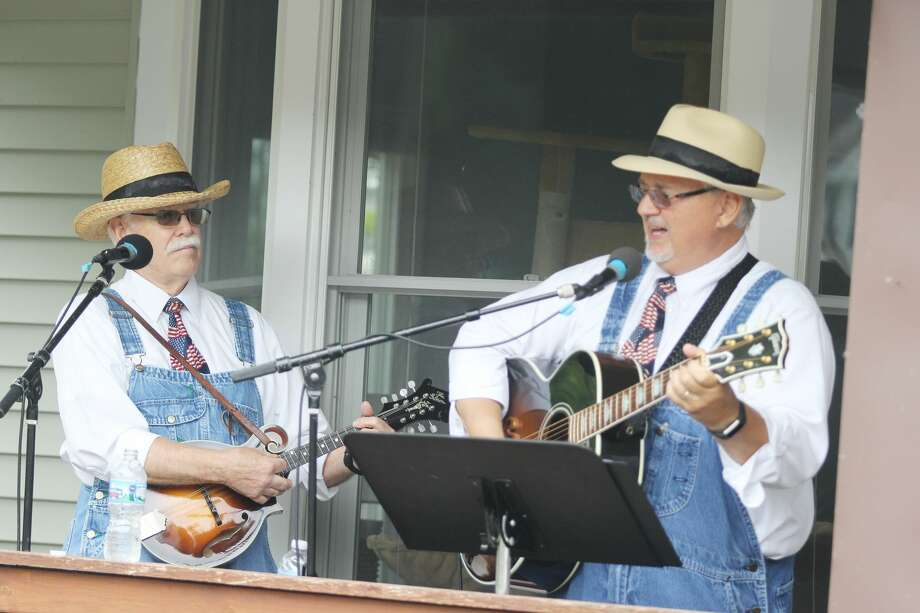 Freddie Willbanks (right) and Randy Stoddard of the Silverwood Bottom Boys perform during Saturday's Porch Fest in Port Austin. The Silverwood Bottom Boys, who were formed in Siverwood, Michigan, were one of about 30 musical groups that performed on porches. Photo: Mike Gallagher/Huron Daily Tribune