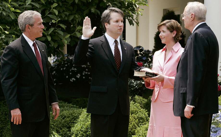 WASHINGTON - JUNE 01:  (AFP OUT)  Brett Kavanaugh (2nd L) is sworn in by Supreme Court Justice Anthony Kennedy (R) to be a judge to the U.S. Circuit Court of Appeals for the District of Columbia as his wife Ashley (2nd R) and U.S. President George W. Bush (L) look on during a swearing-in ceremony at the Rose Garden of the White House June 1, 2006 in Washington, DC. Kavanaugh was confirmed by the Senate with a vote of 57 to 36.  (Photo by Alex Wong/Getty Images) Photo: Alex Wong/Getty Images