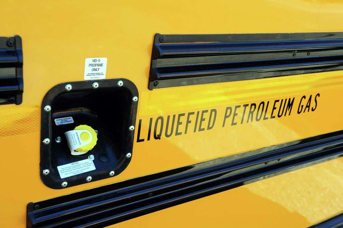 Shelton's new fleet of propane-powered school buses sit in the lot Thursday, Aug. 15, 2013 at the city's bus depot.