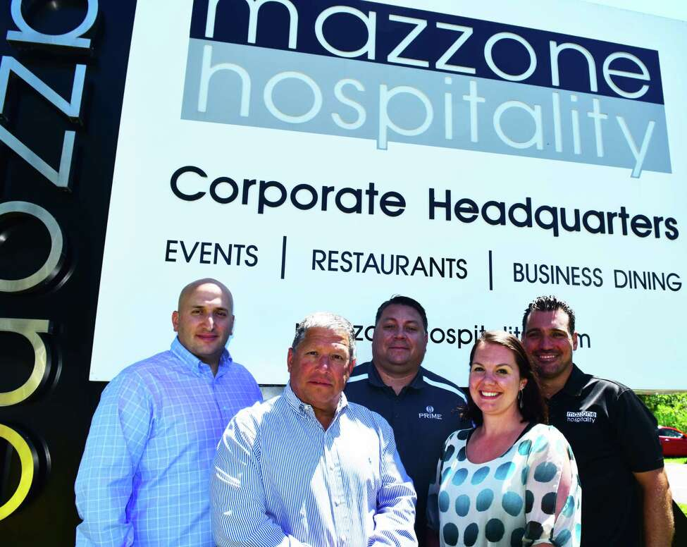 From left, Matt Mazzone, chief financial officer of Mazzone Hospitality; founder and president Angelo Mazzone; Tim Vennard, vice president of business dining; human resources director Justine Ochal; and Sean Willcoxon, regional vice president of catering, outside the compay's Clifton Park headquarters on Monday June 25, 2018. (Steve Barnes/Times Union.)
