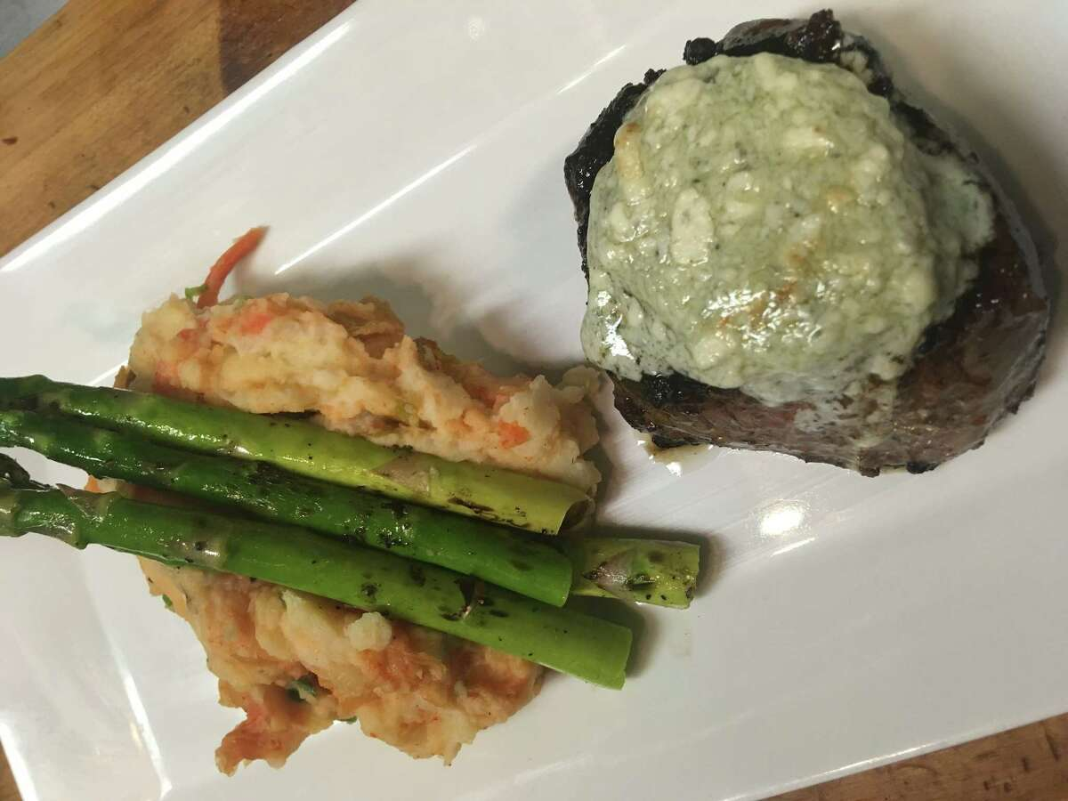 Koji-seasoned steak with Gorgonzola butter, asparaguse and kimchi mashed potatoes at New World Bistro Bar in Albany. (Provided photo.)