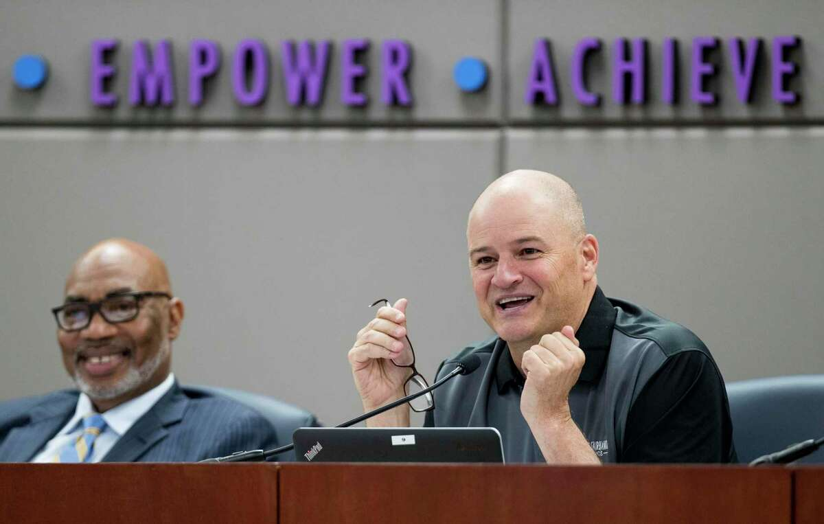 Cy-Fair ISD Superintendent Mark Henry, pictured at right in 2018, said the unprecedented challenges associated with the novel coronavirus prompted district staff to recommend spending up to $44 million on computers for all students and wireless Internet hotspots for families in need. Cy-Fair trustees unanimously approved the request Tuesday.