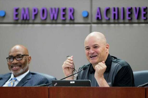 Dr. John Ogletree, Jr., board president, left, and Dr. Mark Henry, superintendent, speak during the Cypress-Fairbanks ISD school board of trustees meeting on Thursday, June 14, 2018, in Cypress. ( Brett Coomer / Houston Chronicle )