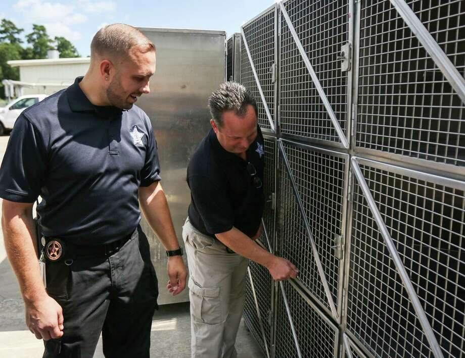 Director Aaron Johnson, left, and assistant director Mark Wysocki, both of the Montgomery County Animal Shelter, show the differences between the old kennels the shelter used, and new ones that were custom built, on Tuesday, June 26, 2018, at the Montgomery County Animal Shelter. Photo: Michael Minasi, Staff Photographer / Houston Chronicle / © 2018 Houston Chronicle