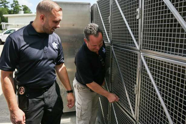 Director Aaron Johnson, left, and assistant director Mark Wysocki, both of the Montgomery County Animal Shelter, show the differences between the old kennels the shelter used, and new ones that were custom built, on Tuesday, June 26, 2018, at the Montgomery County Animal Shelter.
