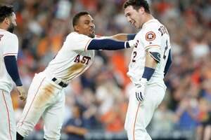Houston Astros third baseman Alex Bregman (2) celebrates with Tony Kemp (18) after hitting a two-run home run  and winning the game for the Houston Astros 7-6 in the bottom of the ninth inning at Minute Maid Park on Wednesday, June 27, 2018 in Houston.