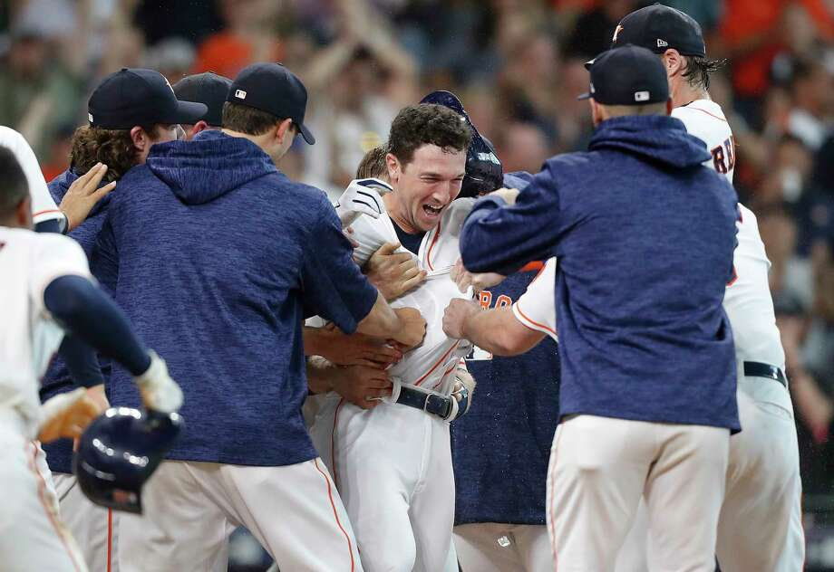 Houston Astros third baseman Alex Bregman (2) is mobbed by his teammates as they celebrate his two-run home run  in the bottom of the ninth inning at Minute Maid Park on Wednesday, June 27, 2018 in Houston. Astros won the game 7-6/ Photo: Elizabeth Conley, Houston Chronicle / ©2018 Houston Chronicle