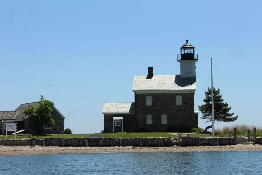 The lighthouse on Sheffield Island turns 150 years old this year; 52 feet tall, it was built because a previous lighthouse was not visible from great distances. Photo: R.A. Schuetz