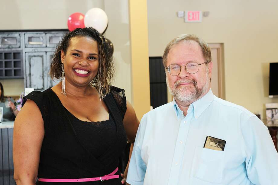 DirectBuy store manager Arlee Elshimily and longtime member Stephen Morris attended the official opening of the new U.S. showroom Friday in Spring. Morris has been a member of the buying club since 1979.