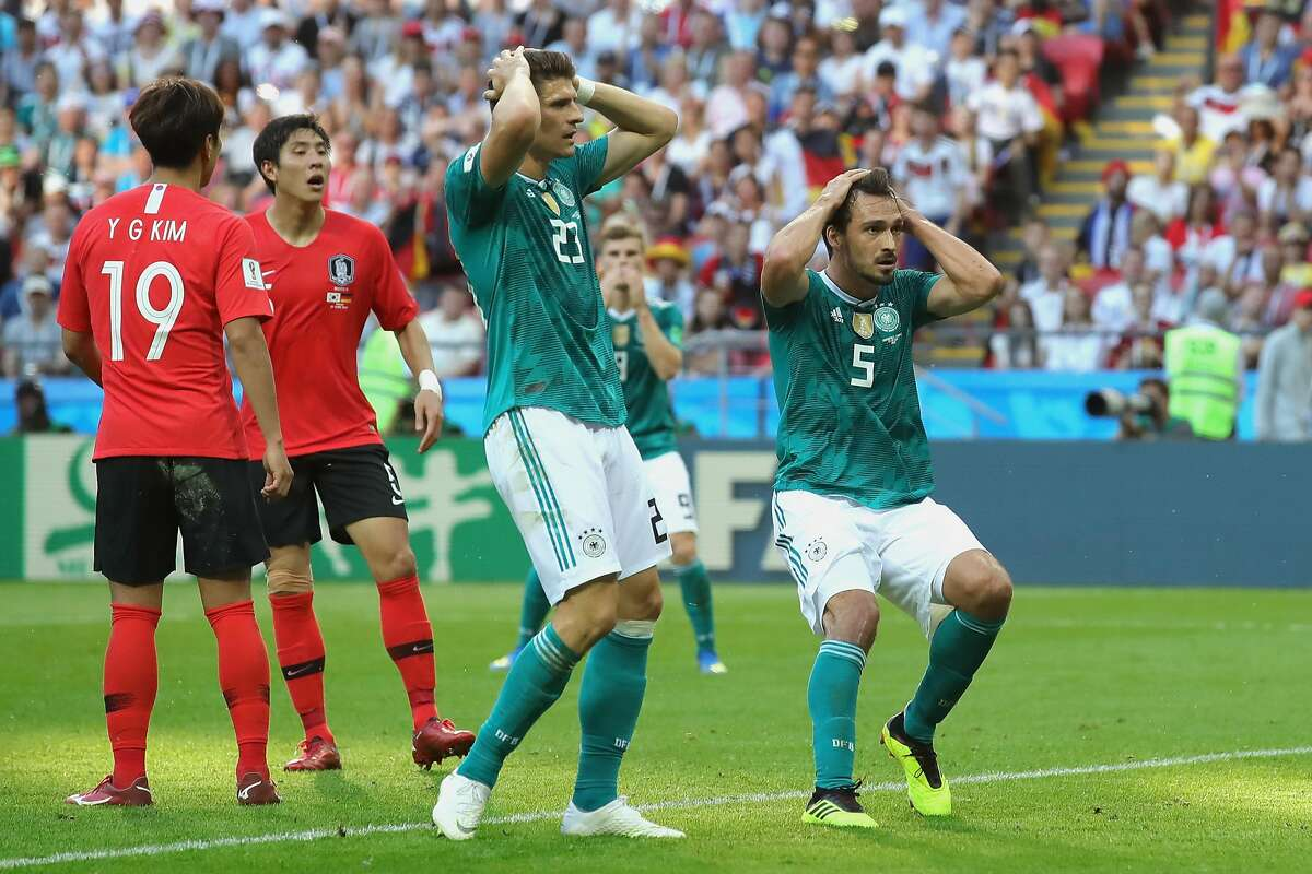 Mats Hummels of Germany and teammate Mario Gomez react during the 2018 FIFA World Cup Russia group F match between Korea Republic and Germany at Kazan Arena on June 27, 2018 in Kazan, Russia.
