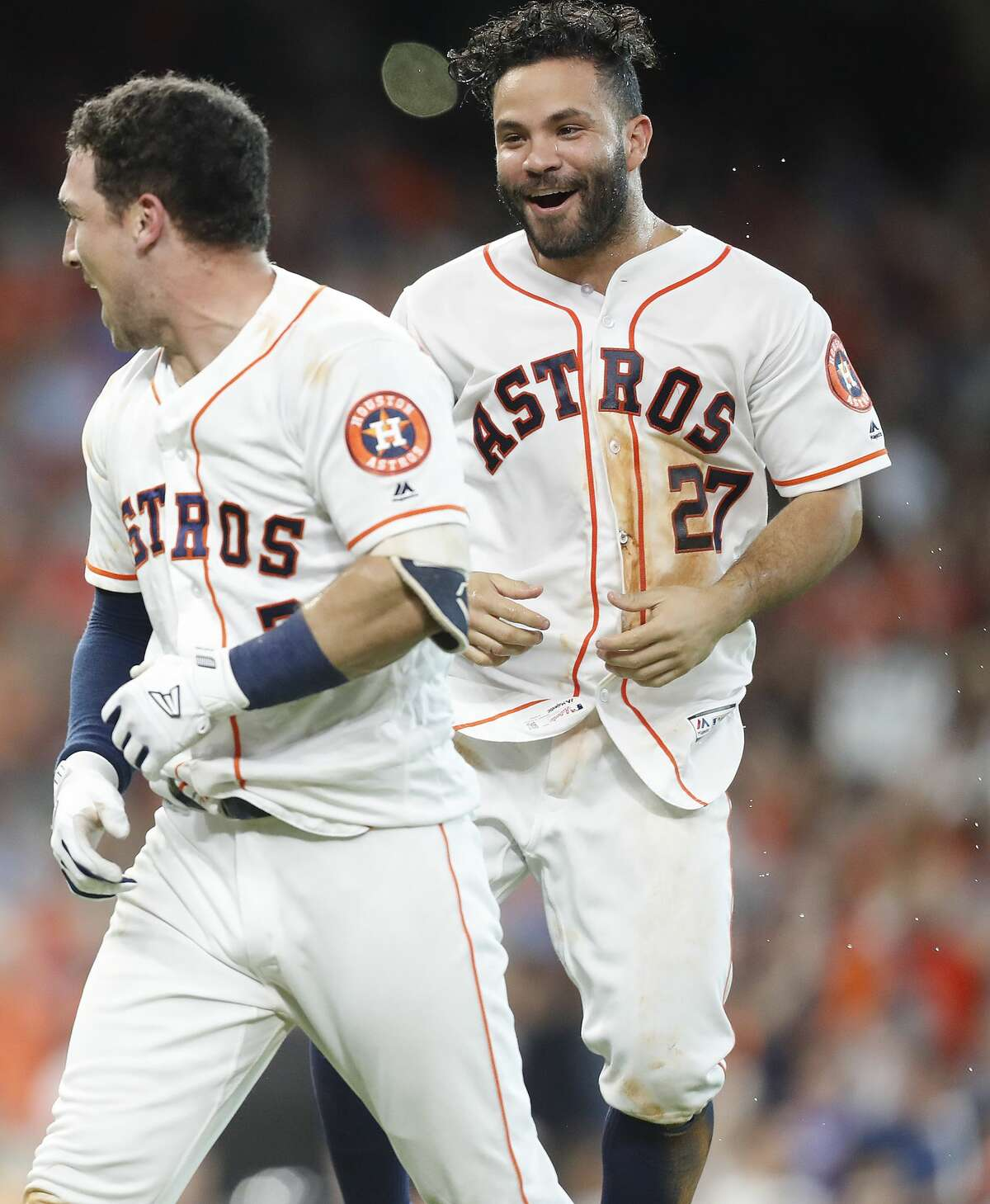 Houston Astros second baseman Jose Altuve (27) celebrates Houston Astros third baseman Alex Bregman (2) two-run walk off home run in the bottom of the ninth inning against Toronto Blue Jays on Wednesday, June 27, 2018 in Houston. Astros won the game 7-6 with a two-run walk off home run. (Elizabeth Conley/Houston Chronicle)