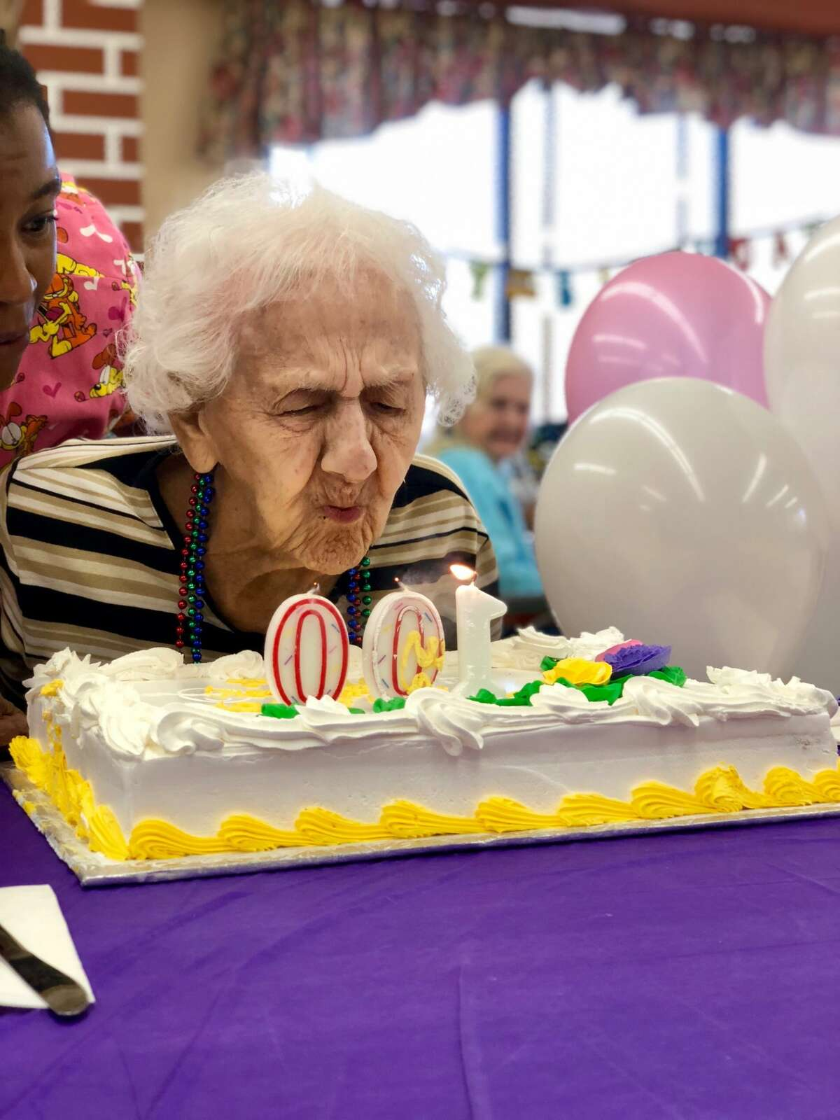 Marie Cunard celebrates her 100th birthday on Tuesday, June 26, 2018, at the Hudson Park Rehabilitation and Nursing Center in Albany, N.Y.
