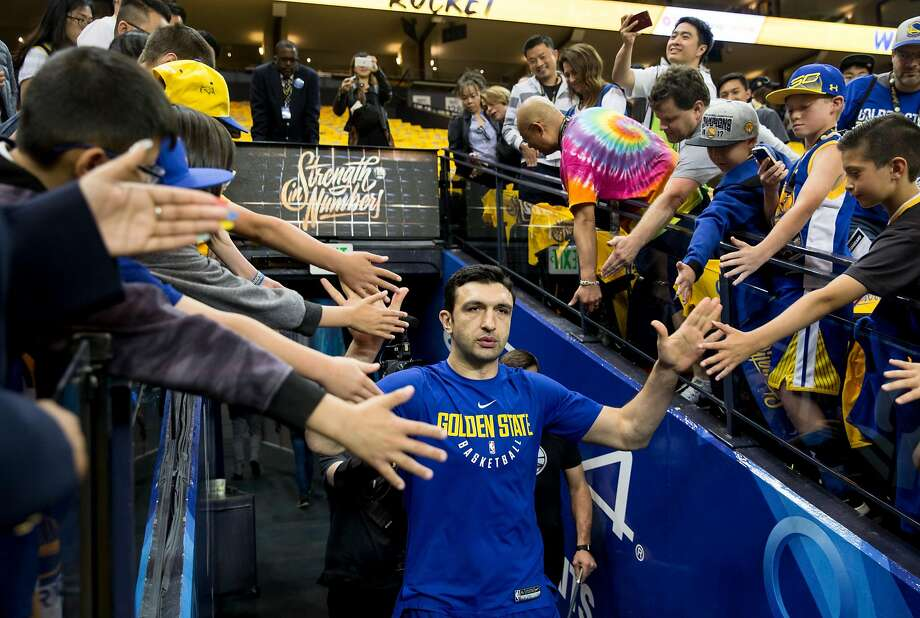 FILE – Warriors' Zaza Pachulia greets fans as he enters the court for warm ups before the Golden State Warriors and Houston Rockets face off during Game 6 of the NBA Western Conference Finals at Oracle Arena in Oakland in this Saturday, May 26, 2018 file photo. Pachulia, who played center for the Dubs from 2016-2018, is joining the Warriors as a team consultant. Photo: Jessica Christian / The Chronicle