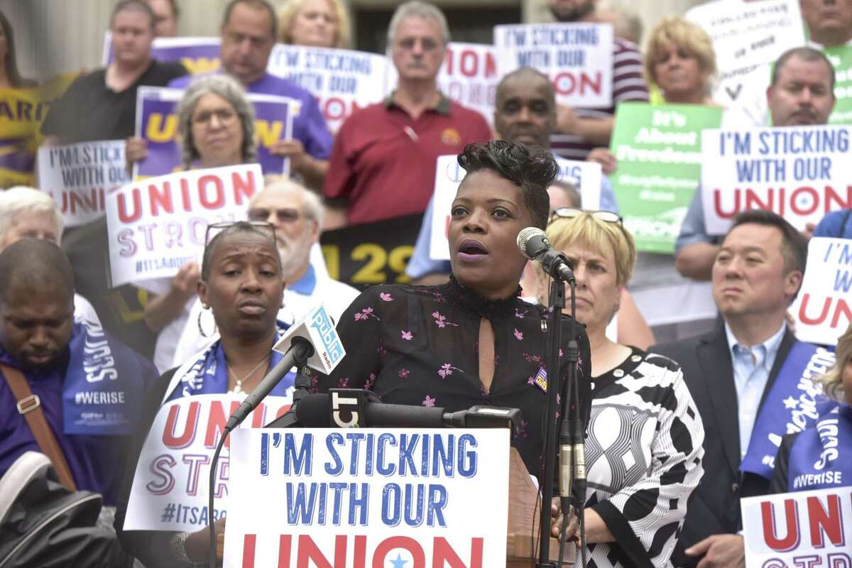 Lynell Brown, mental health associate and member of Service Employees International Union Local 1199, speaks during a news conference Wednesday by workers and labor leaders on the steps of the Connecticut Supreme Court in response to the U.S. Supreme Court on Janus v. AFSCME Council case.