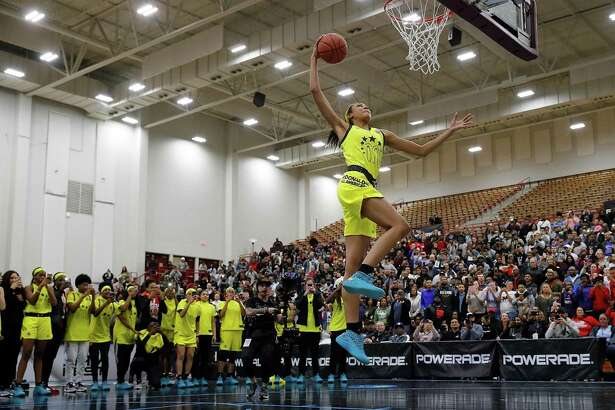 Olivia Nelson-Ododa of Winder-Barrow High School dunks during the 2018 McDonald's All American Game POWERADE Jam Fest at Forbes Arena on March 26, in Atlanta, Georgia.