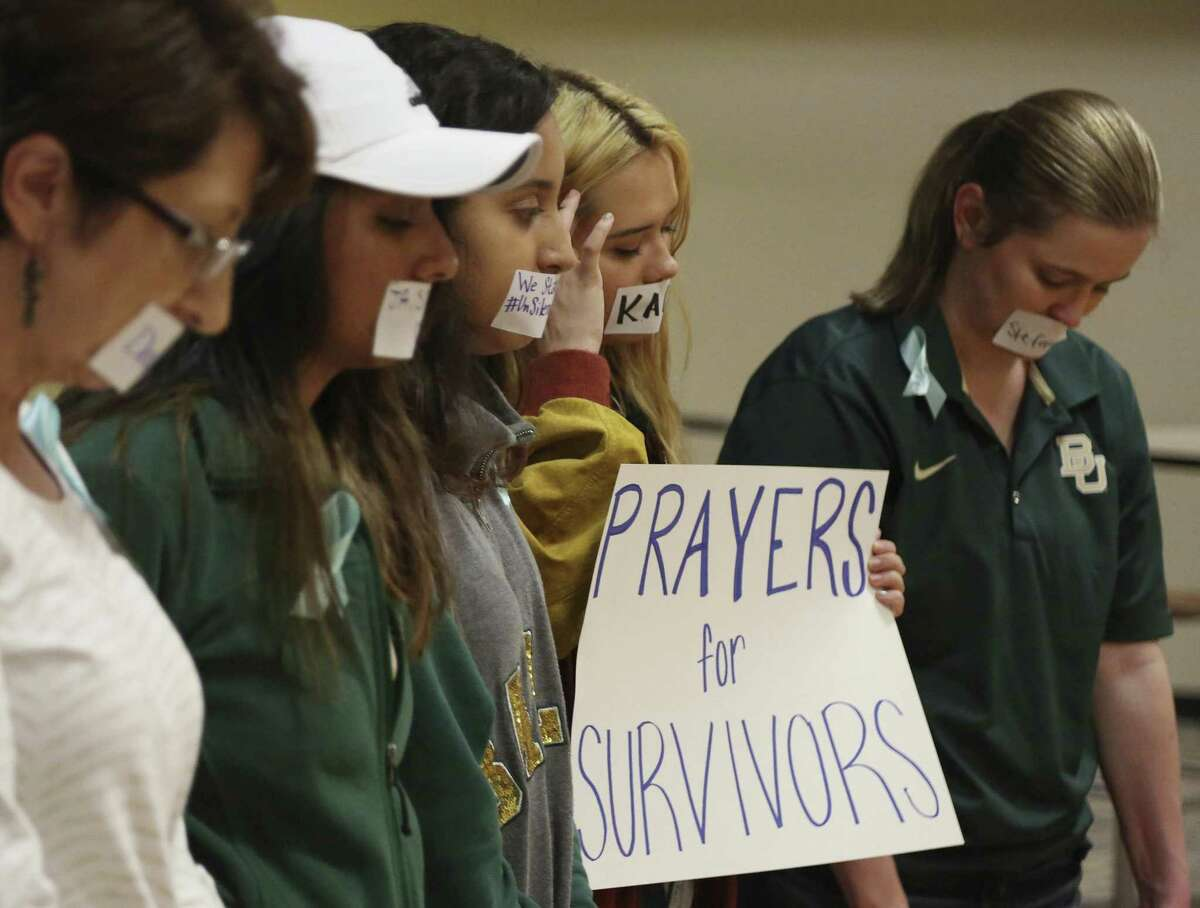 In this June 3, 2016 photo, current and former Baylor students hold a rally warning of sexual assaults on and off campus in Waco.