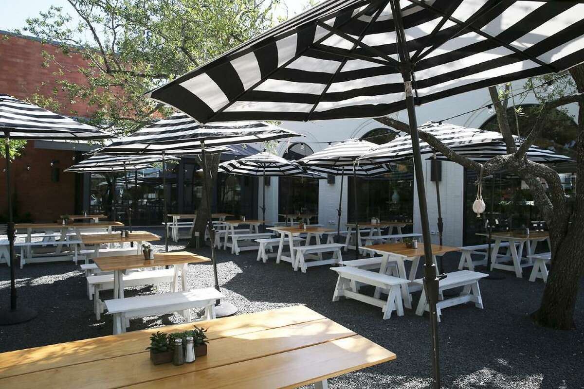 """Down on Grayson's pet-friendly patio likely earned the restaurant its Reader's Choice Award. """"The tables are far enough away from each other, so you're not in someone else's way,"""" said Kate Courtney, a project manager at the restaurant."""