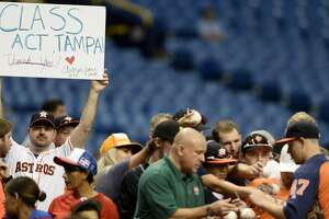 ST. PETERSBURG, FL - AUGUST 30:  An Astros fan thanks Tampa, as Chris Devenski #47 of the Houston Astros signs autographs, before their game versus the Texas Rangers at Tropicana Field on August 30, 2017 in St. Petersburg, Florida. (Photo by Jason Behnken / Getty Images)