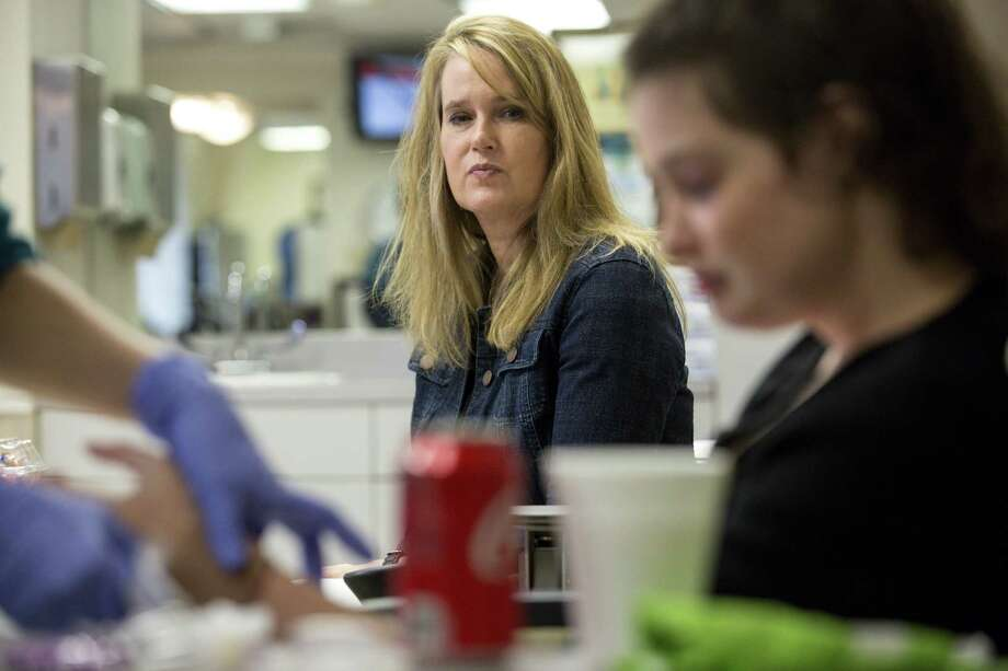 Susan Baker watches as her daughter Tiffany undergoes a medical procedure, Monday, April 9, 2018, in Houston.  ( Jon Shapley / Houston Chronicle ) Photo: Jon Shapley/Houston Chronicle / © 2018 Houston Chronicle