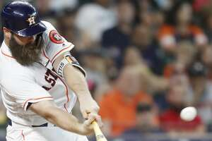 Houston Astros catcher Evan Gattis (11) connects for an RBI double that brought in Houston Astros third baseman Alex Bregman (2) bringing the Astros within 1 run of the Toronto Blue Jays  on Wednesday, June 27, 2018 in Houston.  (Elizabeth Conley/Houston Chronicle)