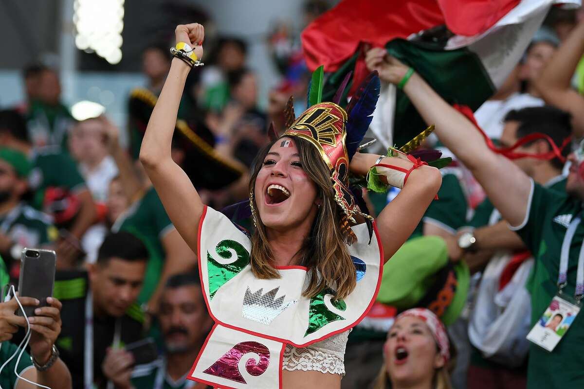 Mexico fans celebrate after hearing the news of a Korea Republic goal that will send Mexico in Round of 16 during the 2018 FIFA World Cup Russia group F match between Mexico and Sweden at Ekaterinburg Arena on June 27, 2018 in Yekaterinburg, Russia. (Photo by Matthias Hangst/Getty Images)