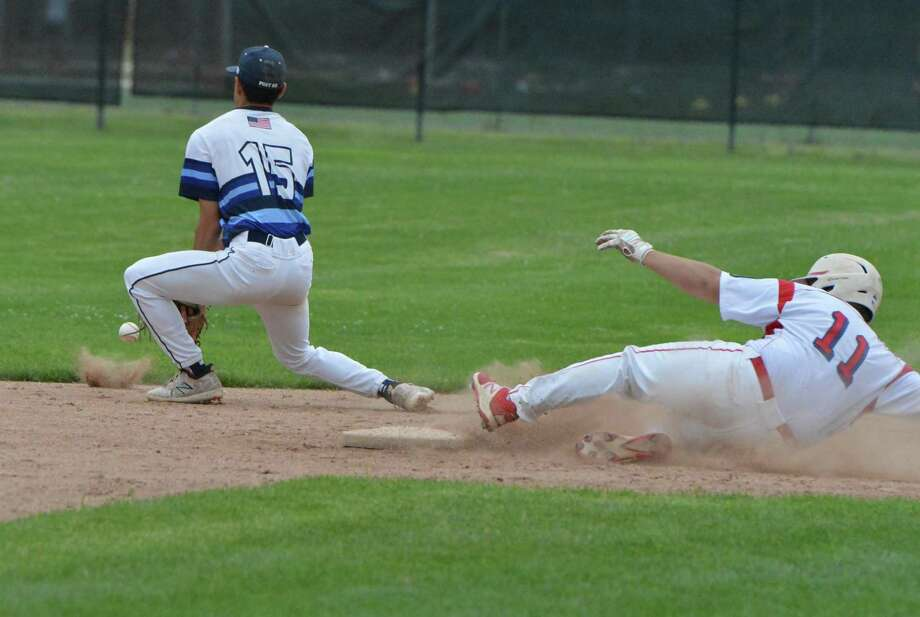 Greenwich's Hunter Gruenstrass slides safely into second base against Westport during an American Legion baseball game in Greenwich. Photo: Alex Von Kleydorff / Hearst Connecticut Media / Norwalk Hour