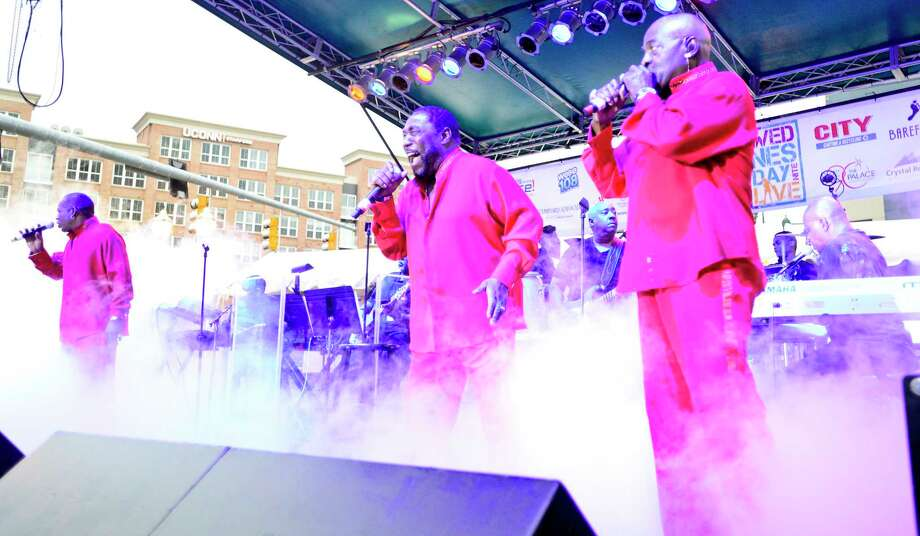 From left, Eric Nolan Grant, Eddie Levert, and Walter Williams, Sr. of The O'Jays perform during the kickoff of the Wednesday Night Live concert series at Columbus Park on June 27, 2018 in Stamford, Connecticut. Photo: Matthew Brown, Hearst Connecticut Media / Stamford Advocate