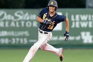 Colton Cowser (10) of Cy-Ranch rounds second base after hitting a 2-RBI triple to right field in the third inning of game 3 of the 6A-III regional final playoff series between the Cy-Fair Bobcats and the Cy-Ranch Mustangs on Saturday June 2, 2018 at the University of Houston Schroeder Park, Houston, TX.