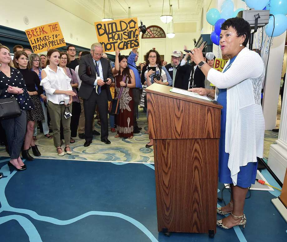 Mayor Toni N. Harp speaks at the opening of Ives Squared at the New Haven Free Public Library on Elm Street, Wednesday, June 27, 2018. Protestors stood in the crowd demanding housing for homeless. Photo: Catherine Avalone, Hearst Connecticut Media / New Haven Register
