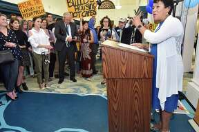 Mayor Toni N. Harp speaks at the opening of Ives Squared at the New Haven Free Public Library on Elm Street, Wednesday, June 27, 2018. Protestors stood in the crowd demanding housing for homeless.