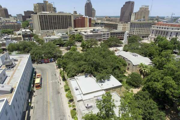 Crockett Street separates the Menger Hotel, left, from the Alamo and Alamo Plaza. A proposed Alamo Plaza redesign plan released in June calls for closing Crockett Street, among numerous other changes.