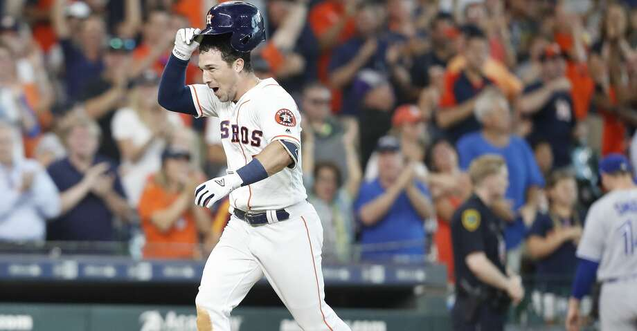 Houston Astros third baseman Alex Bregman (2) celebrates as he runs home after hitting a two-run home run  in the bottom of the ninth inning at Minute Maid Park on Wednesday, June 27, 2018 in Houston. Astros won the game 7-6/  (Elizabeth Conley/Houston Chronicle) Photo: Elizabeth Conley/Houston Chronicle