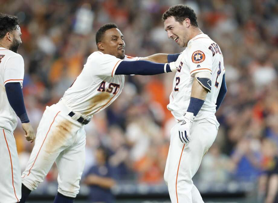 Houston Astros third baseman Alex Bregman (2) celebrates with Tony Kemp (18) after hitting a two-run home run  and winning the game for the Houston Astros 7-6 in the bottom of the ninth inning at Minute Maid Park on Wednesday, June 27, 2018 in Houston.  (Elizabeth Conley/Houston Chronicle) Photo: Elizabeth Conley/Houston Chronicle