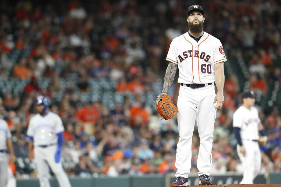 Houston Astros starting pitcher Dallas Keuchel (60) reacts to his performance in the first inning against the Toronto Blue Jays  at Minute Maid Park on Wednesday, June 27, 2018 in Houston. Toronto scored 5 runs in the first inning. (Elizabeth Conley/Houston Chronicle) Photo: Elizabeth Conley/Houston Chronicle