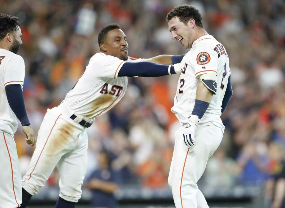 With Tony Kemp, left, scoring in front of Alex Bregman on the third baseman's ninth-inning homer, the Astros could shove off to Tampa triumphantly. Photo: Elizabeth Conley, Chronicle / Houston Chronicle / ©2018 Houston Chronicle