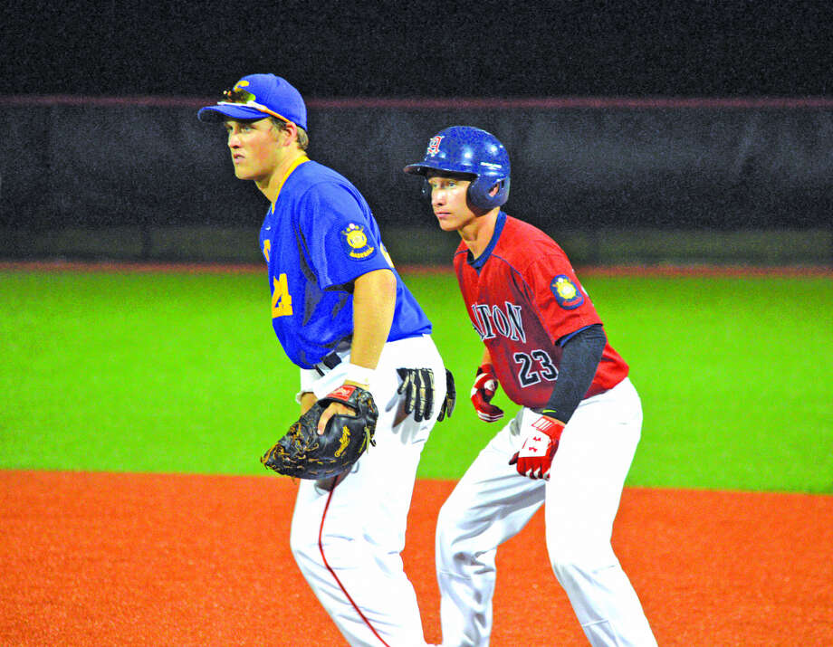 Reid Hendrickson, left, plays first base for Edwardsville Post 199 while Alton's Cullen McBride takes a lead during the second game of Monday's doubleheader at SIUE.