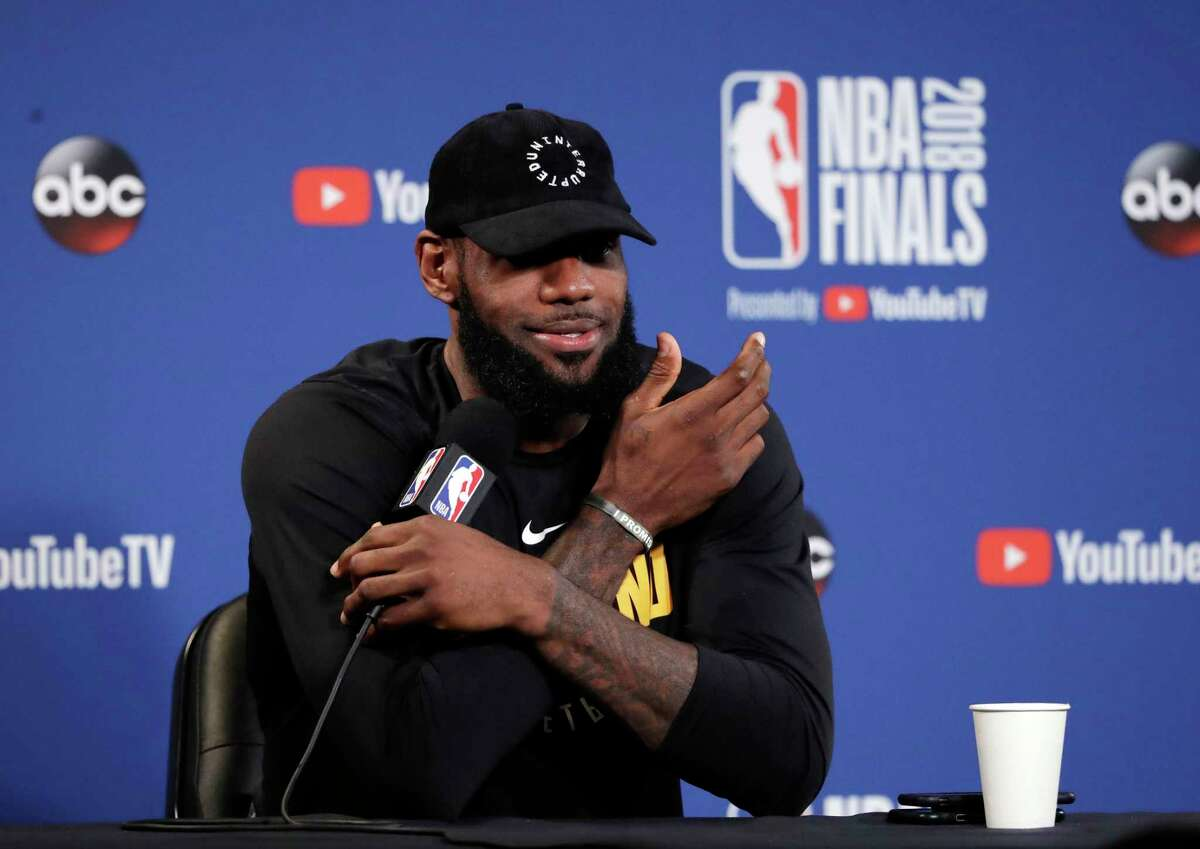 Cleveland Cavaliers' LeBron James fields questions before an NBA basketball practice, Wednesday, May 30, 2018, in Oakland, Calif. The Cavaliers face the Golden State Warriors in Game 1 of the NBA Finals on Thursday in Oakland. (AP Photo/Marcio Jose Sanchez)