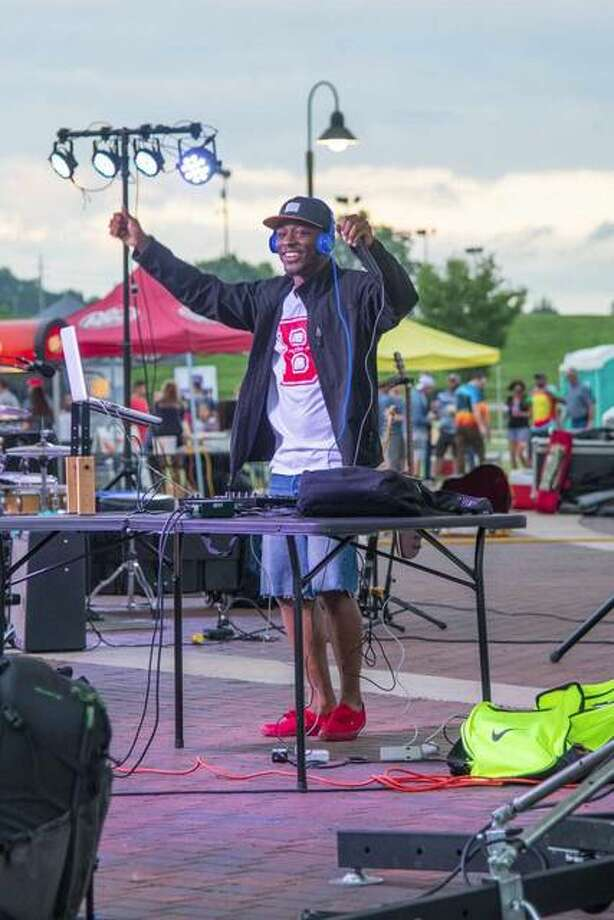 Keith on da Beat (Mikeith Teague) entertains the crowd during the finale of the Small Business Revolution Season 3 at the Alton Amphitheater. Photo:       Andrew Dobson | For The Telegraph