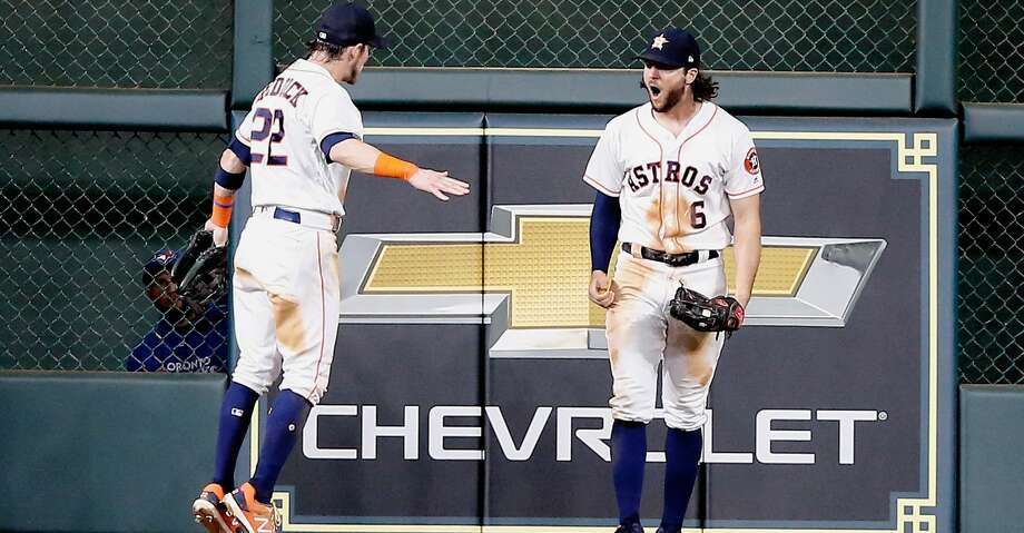 HOUSTON, TX - JUNE 26:  Jake Marisnick #6 of the Houston Astros celebrates with Josh Reddick #22 after making a catch at the wall by Justin Smoak #14 of the Toronto Blue Jays at Minute Maid Park on June 26, 2018 in Houston, Texas.  (Photo by Bob Levey/Getty Images) Photo: Bob Levey/Getty Images