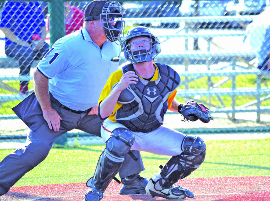 Edwardsville Post 199 catcher Will Messer looks for a foul ball during the second inning of Wednesday's game against Valmeyer at the Edwardsville High School Junior varsity field.