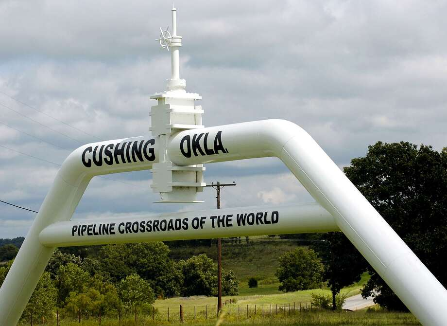 In this Sept. 15, 2005 file photo, the marker that welcomes commuters to Cushing, Okla. is seen. Canadian company TransCanada says it will build an oil pipeline from Oklahoma to Texas after President Barack Obama blocked the larger Keystone XL pipeline from Canada. The company says the new project does not require presidential approval since it does not cross a U.S. border. The shorter pipeline is expected to cost about $2.3 billion and be completed in 2013. The Obama administration had suggested development of an Oklahoma-to-Texas line to alleviate an oil glut at a Cushing, Okla., storage hub. (AP Photo/The Oklahoman, Matt Strasen, File) Photo: Matt Strasen, MBR / AP / The Oklahoman